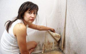 Woman revealing black mold